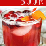 Cranberry whiskey sour in a glass. Text overlay for Pinterest.