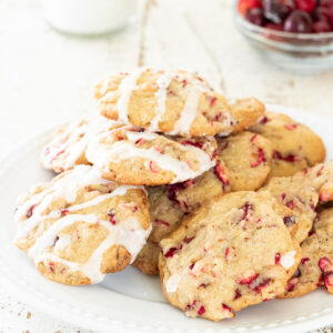 Plate stacked with cranberry cookies.