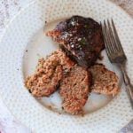 Finished air fryer meatloaf sliced on a plate.