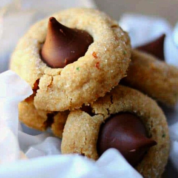 Peanut Butter Kiss Cookies on white tissue paper.