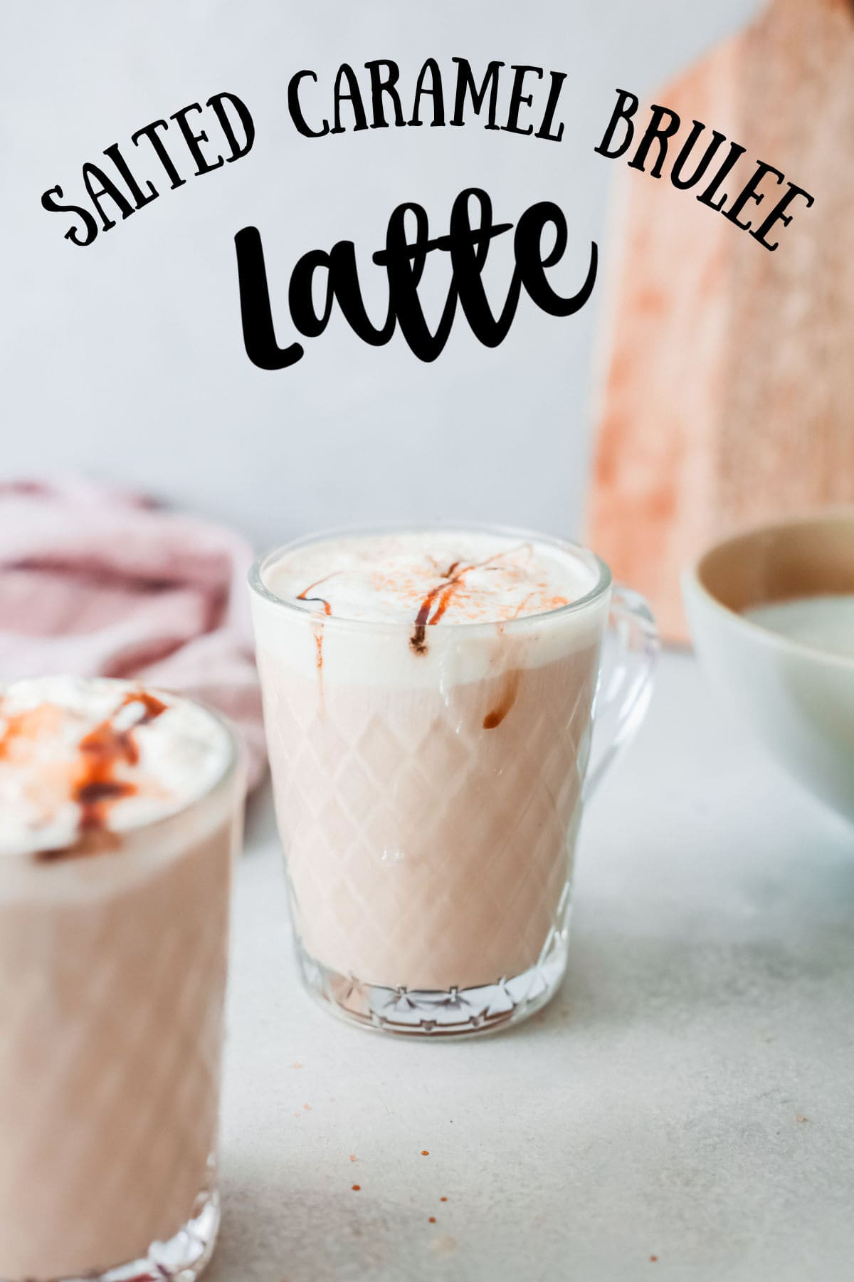 A salted caramel brulee latte in a glass coffee cup with title text overlay.