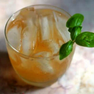 Overhead view of a tequila and ginger ale cocktail.