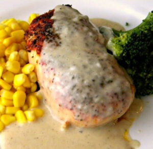 Baked chicken breast with creamy gravy.