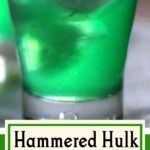 Green cocktail with text for Pinterest.