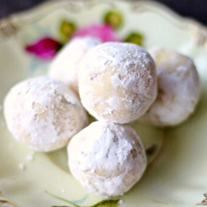 Lavender and lemon white chocolate truffles on a plate.