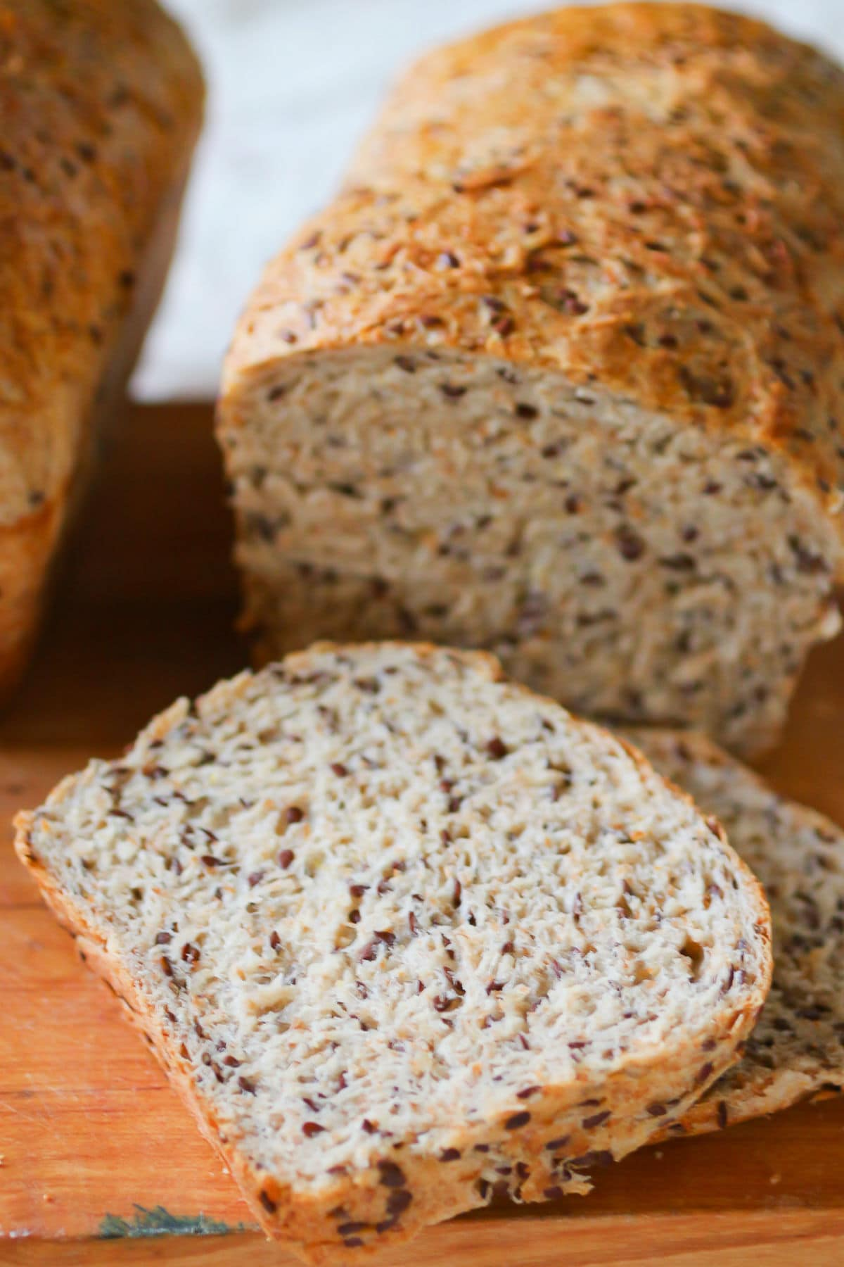 Multigrain bread sliced to show the internal texture with the flaxseeds.