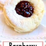 Two round scones with raspberry jam in the center. Text overlay for Pinterest.