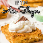 A closeup of French toast garnished with whipped cream. Title text overlay for Pinterest.