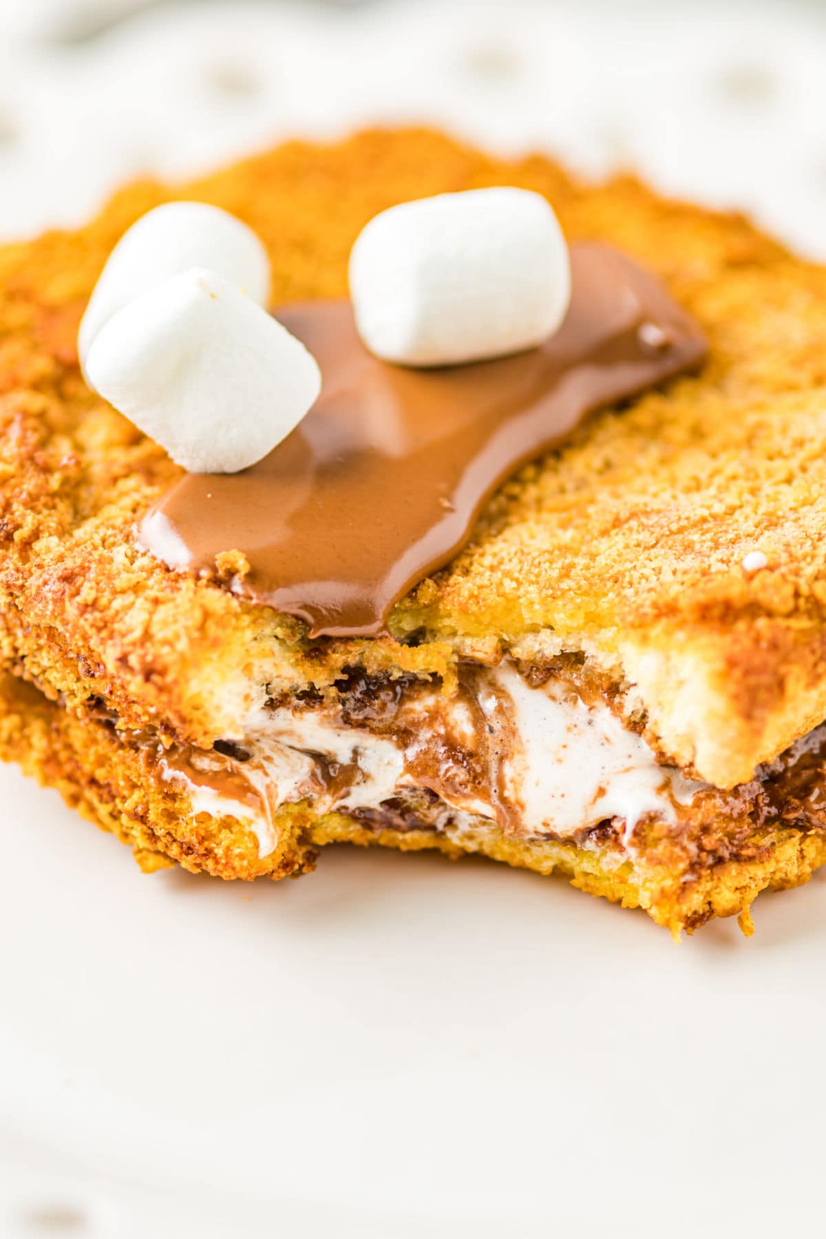A close up of the air fryer stuffed French toast showing the filling.