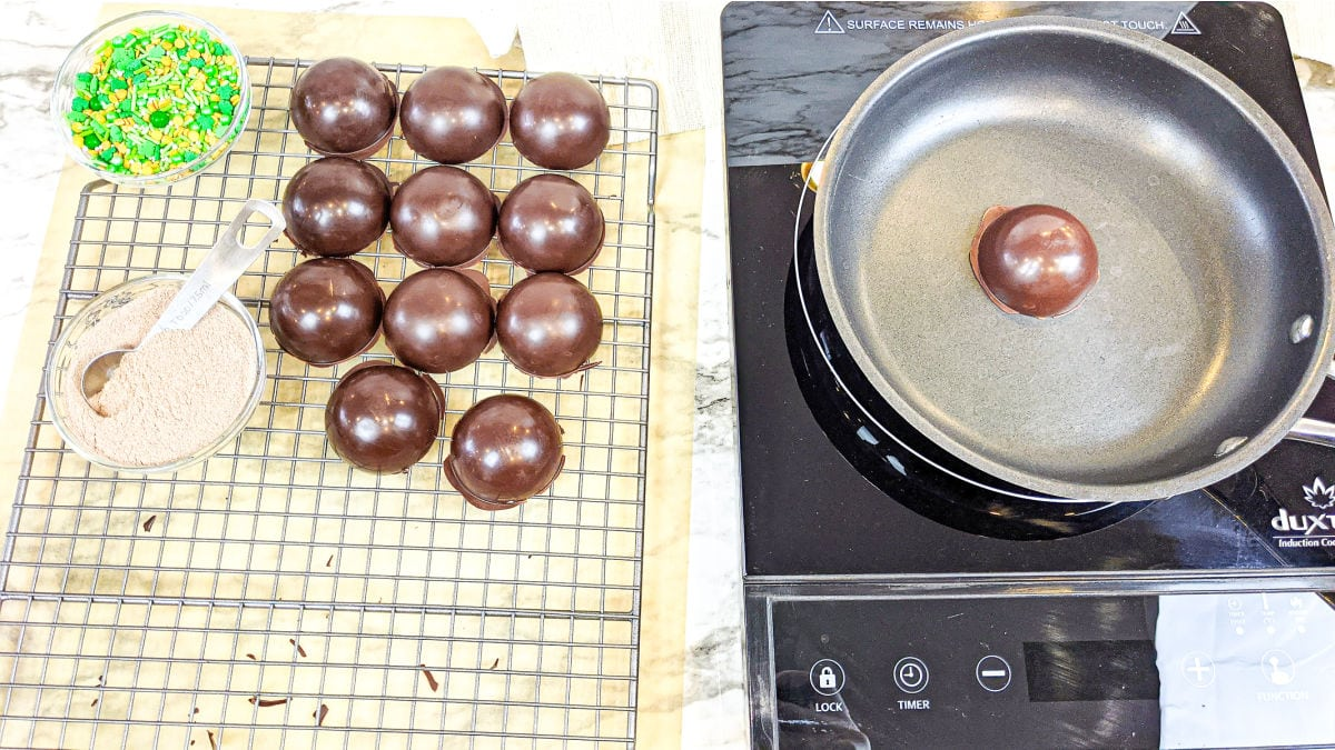 Warming the chocolate shells in a pan.