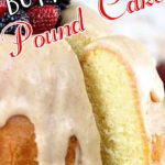 A pound cake with berries on top. Text overlay for Pinterest.