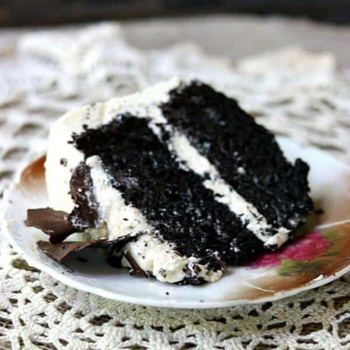 A slice of dark chocolate layer cake with Irish cream frosting.