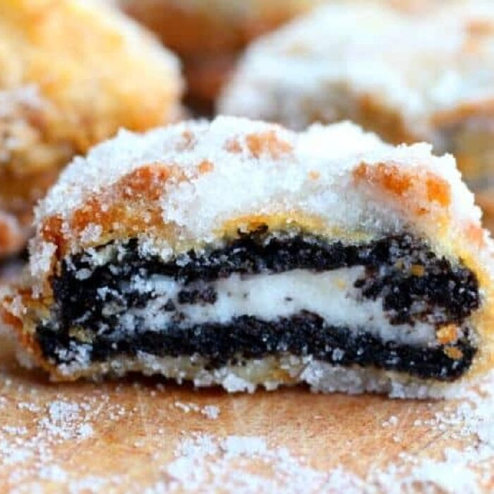 A battered and fried Oreo cut in half to show layers.