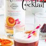 A tequila and grapefruit cocktail with a text overlay for Pinterest.
