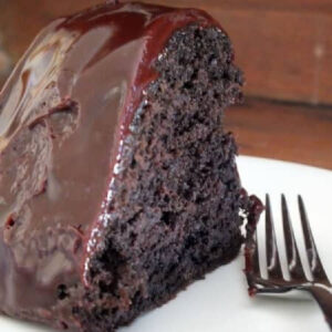 A slice of Guinness Chocolate bundt cake on a plate.