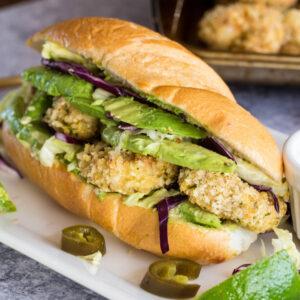 Close up of a shrimp sandwich with avocado.