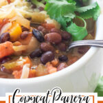 Close up of black bean soup in a white bowl with text overlay for Pinterest.