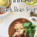 Overhead view of black bean soup in a white bowl with a text overlay for Pinterest.