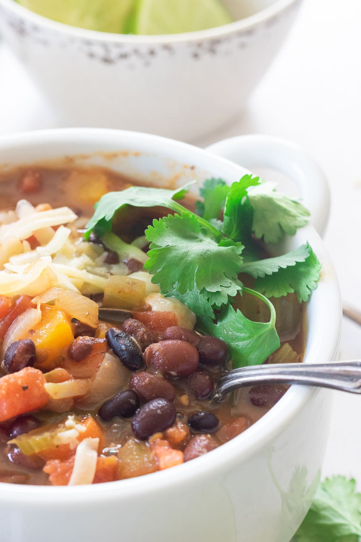 Closeup of a bowl of soup with black beans and cilantro.