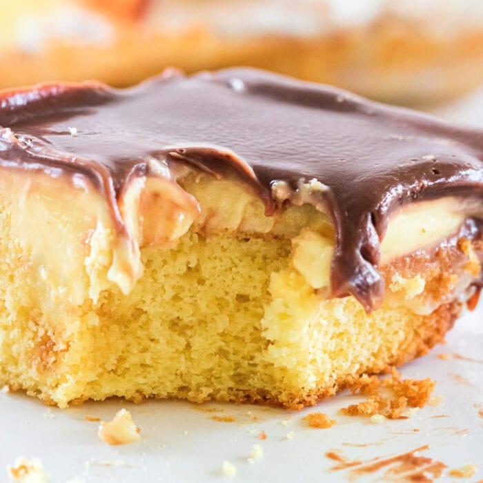 Close up of Boston cream cake showing the gooey ganache glaze.