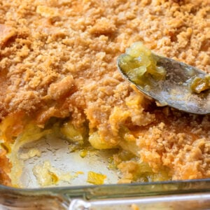 Very close shot of pineapple casserole showing the texture of the cracker crumb topping.