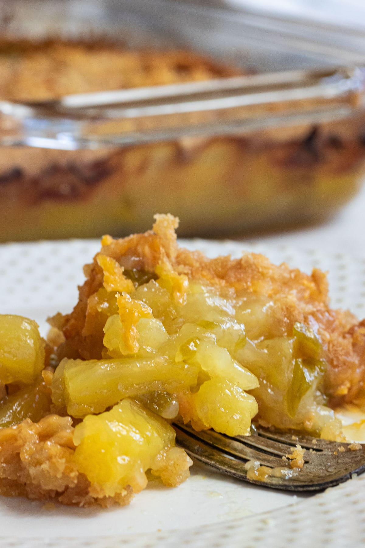 Close up of a serving of pineapple and cheese casserole.