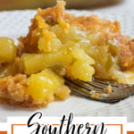 Closeup of a serving of casserole showing the sticky sweet pineapple filling. Text overlay for pinning to Pinterest.