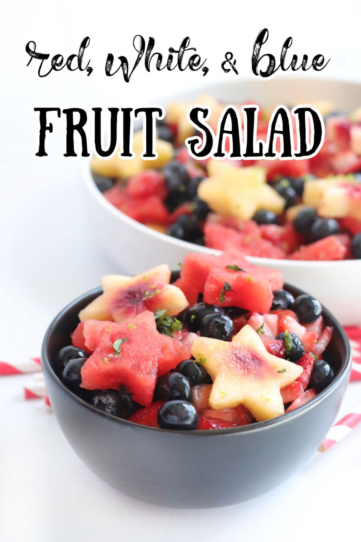 Side view of a bowl with watermelon, peaches, and blueberries. A title text overlay says red white and blue fruit salad.