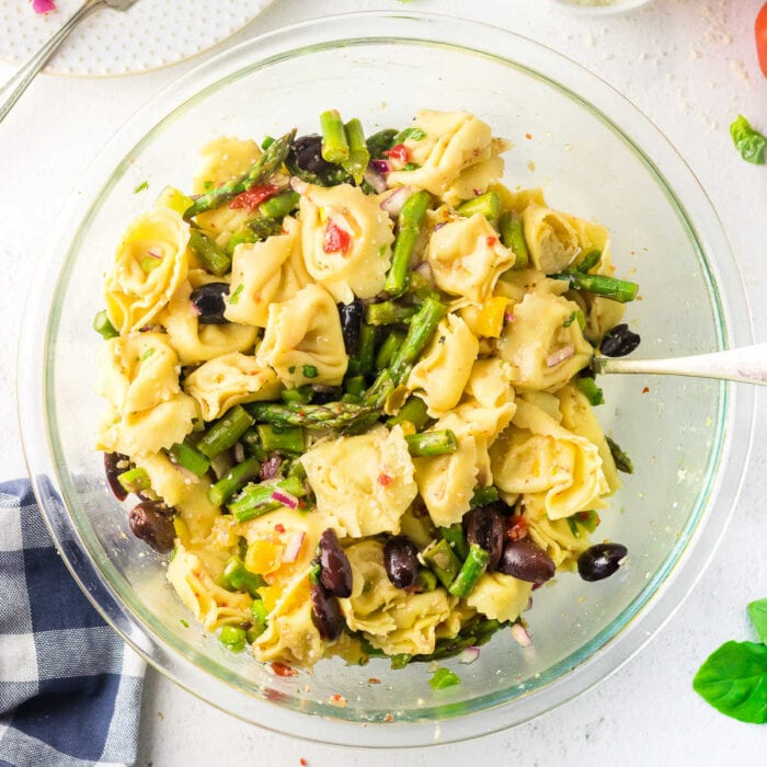 Overhead view of Italian cheese tortellini salad with asparagus.