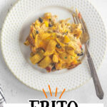 Overhead view of Frito Casserole on a plate with a fork nearby. Text overlay for Pinterest