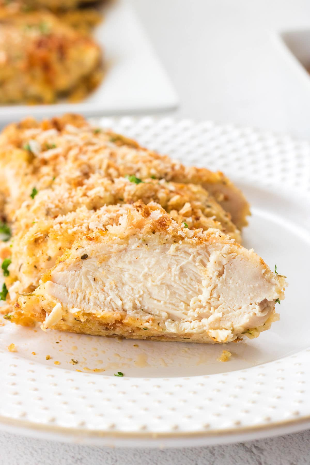 A close up of the finished chicken dish, sliced in bite sized pieces.
