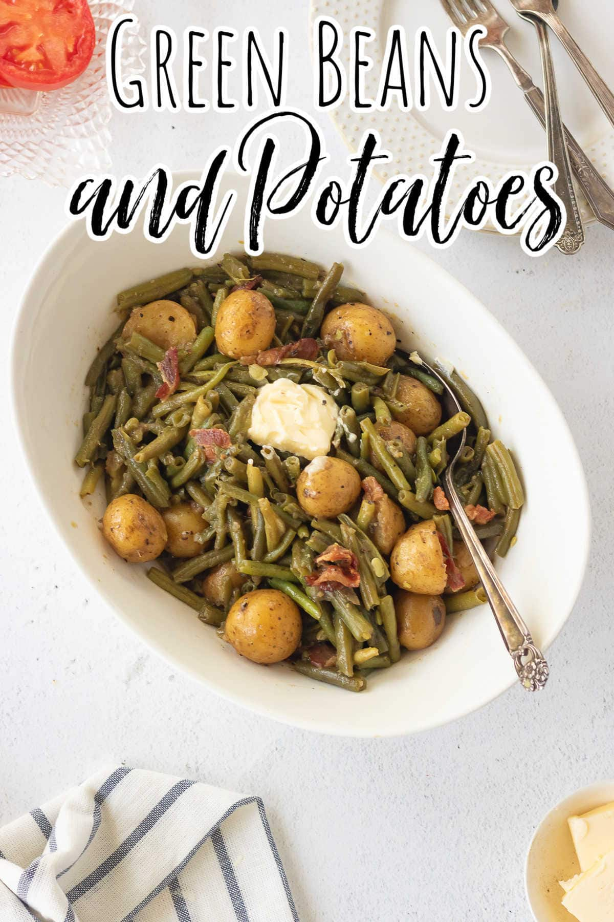 Overhead view of a serving bowl of green beans and potatoes with text overlay for Pinterest.