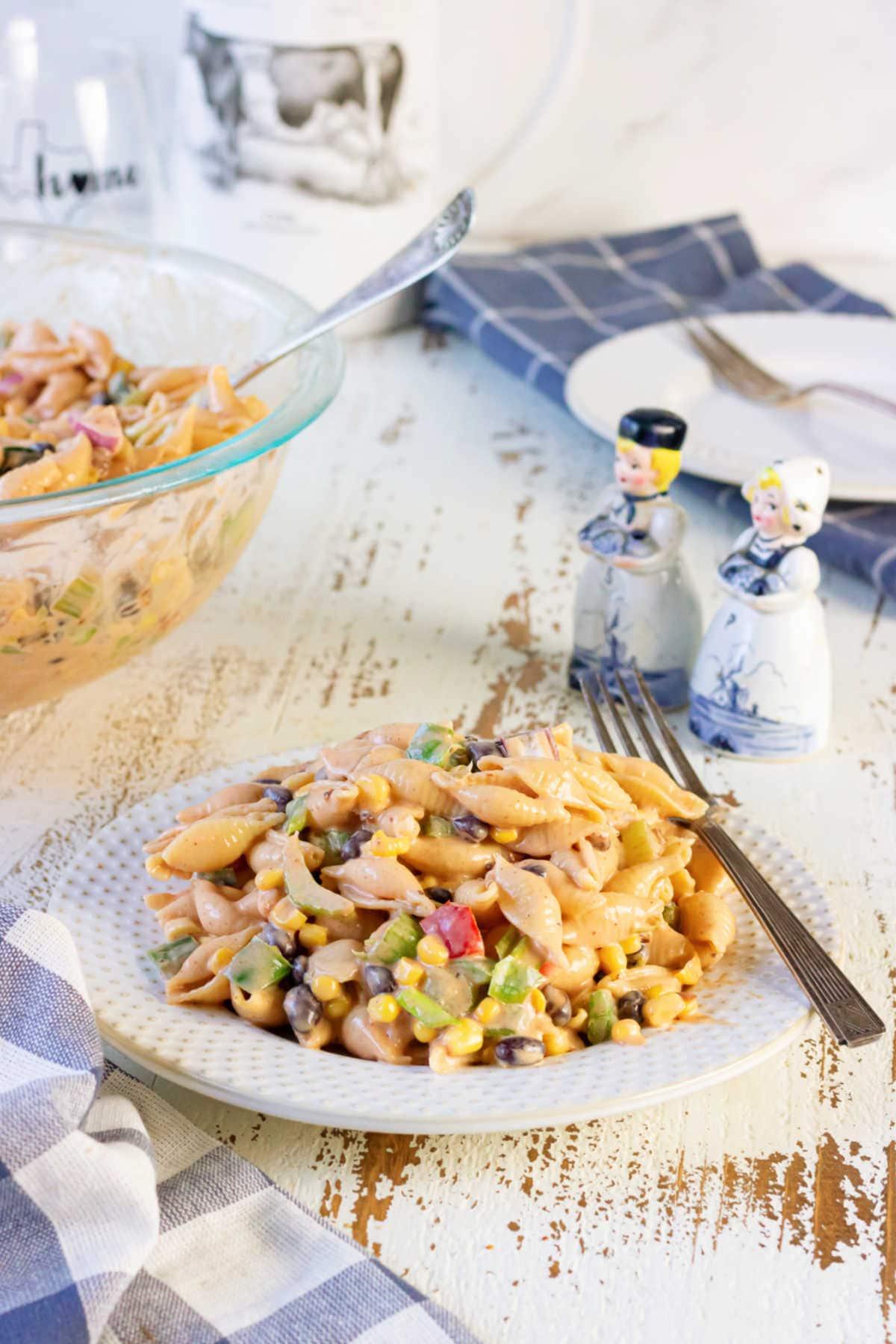 A plateful of bbq macaroni salad on a table.