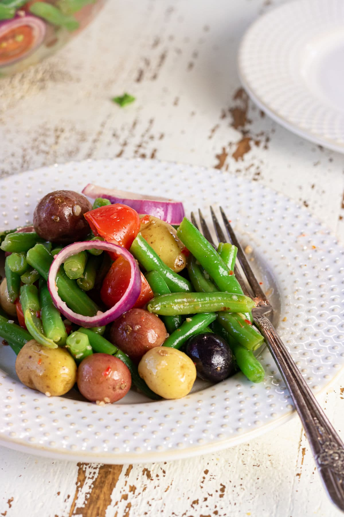 Decorative image. Close up of a plate of the salad with a fork in it.
