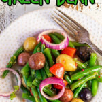 Overhead view of a plate of salad with title text overlay for Pinterest.