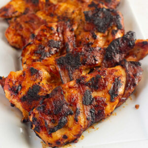 Close up of chicken breast that's been grilled.