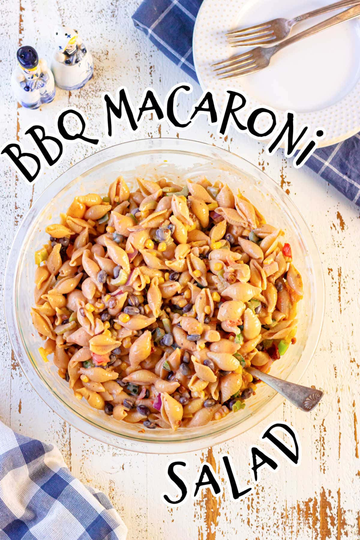 Overhead view of a bowl of macaroni salad with a title text overlay.