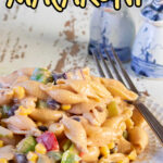 Side view of a plate of bbq pasta salad with text overlay for Pinterest.