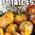 Closeup of finished potatoes in foil with text overlay for Pinterest.