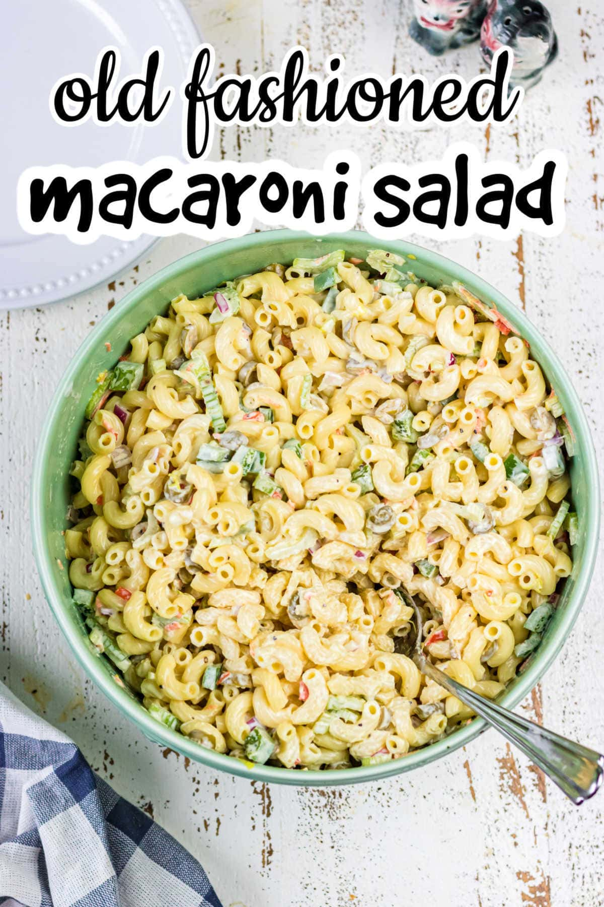 Title image - overhead view of macaroni salad in a green bowl with title text overlay.