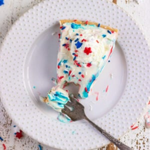 Overhead view of a slice of the finished pie garnished with red, white, and blue sprinkles.