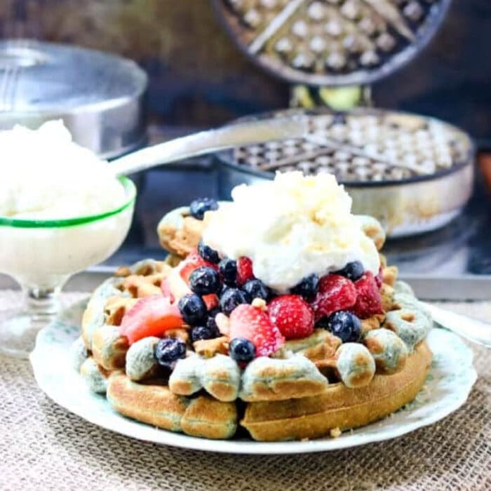 Waffles with berries on top.