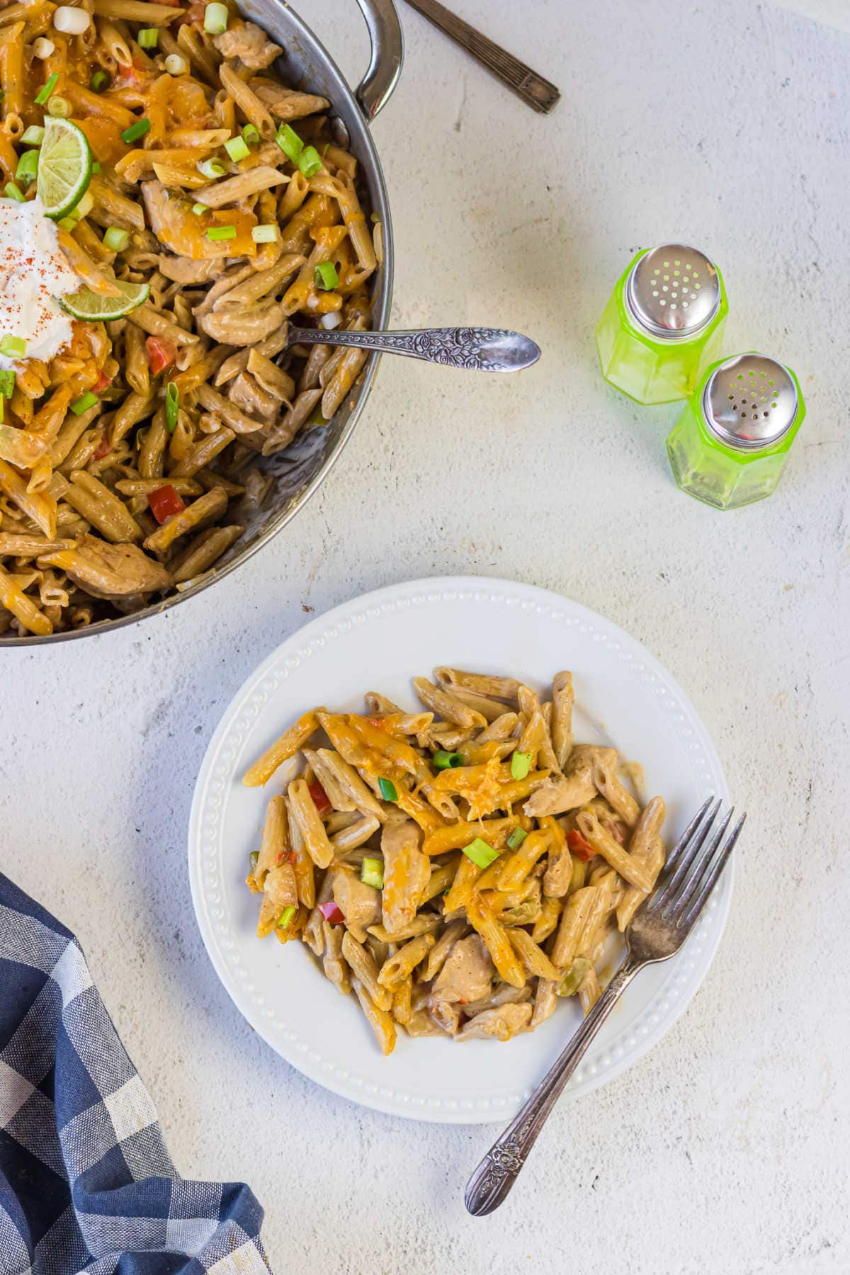 Overhead view of a serving of chicken fajita pasta on a plate.