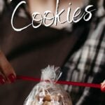 Woman tying a bow on a package of cookies with text overlay for Pinterest.