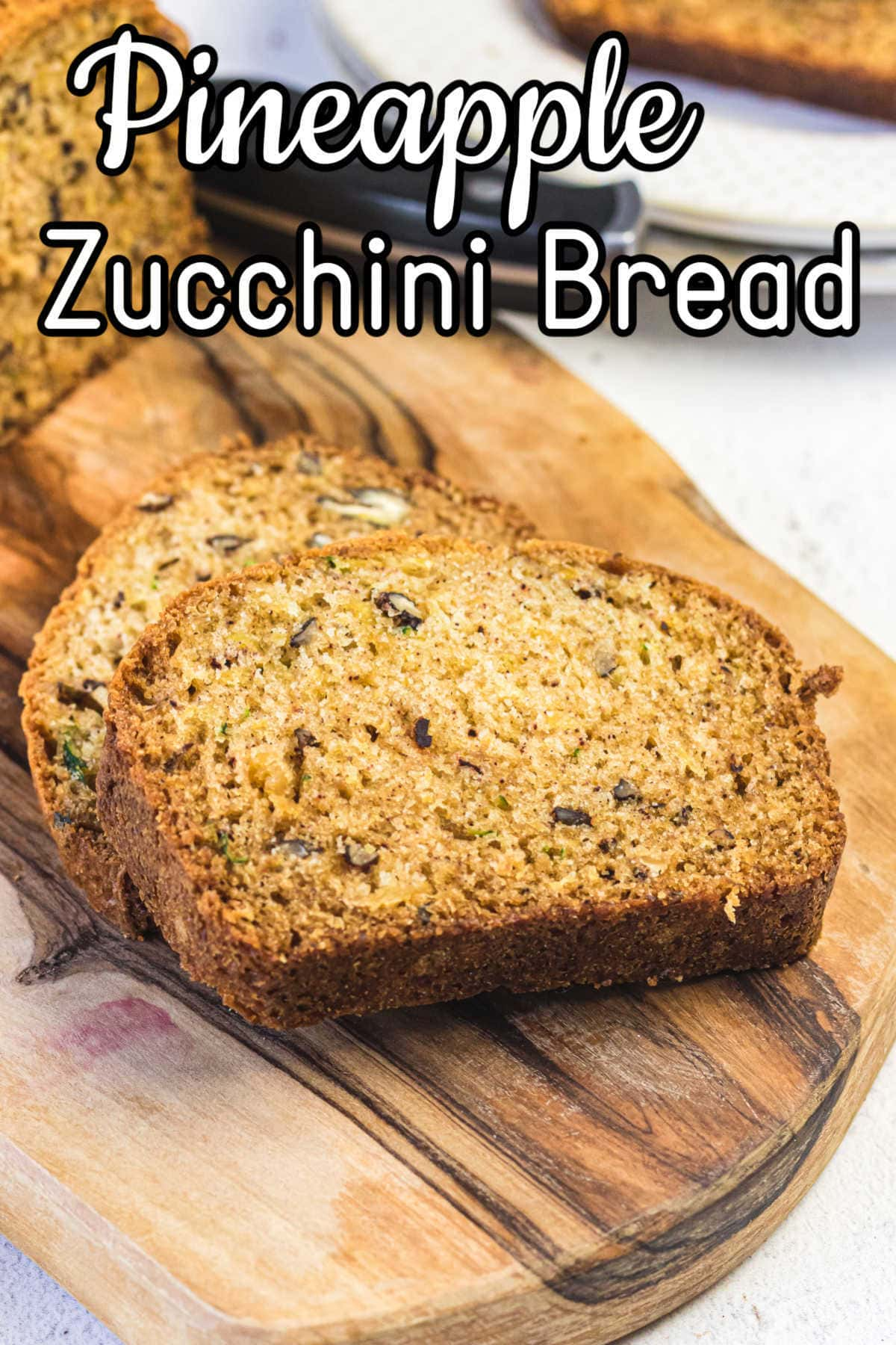 Closeup of the zucchini bread slices showing texture. Title text overlay.