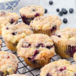 Blueberry muffins on a cooling rack. Feature image.
