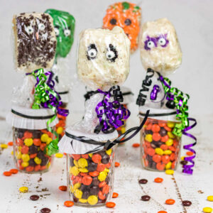 A collection of the finished Halloween Rice Krispie Treats on sticks.