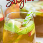 Closeup pf a glass of apple sangria with a text overlay for Pinterest.