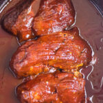 Closeup of the cooked pork ribs with text overlay for Pinterest.