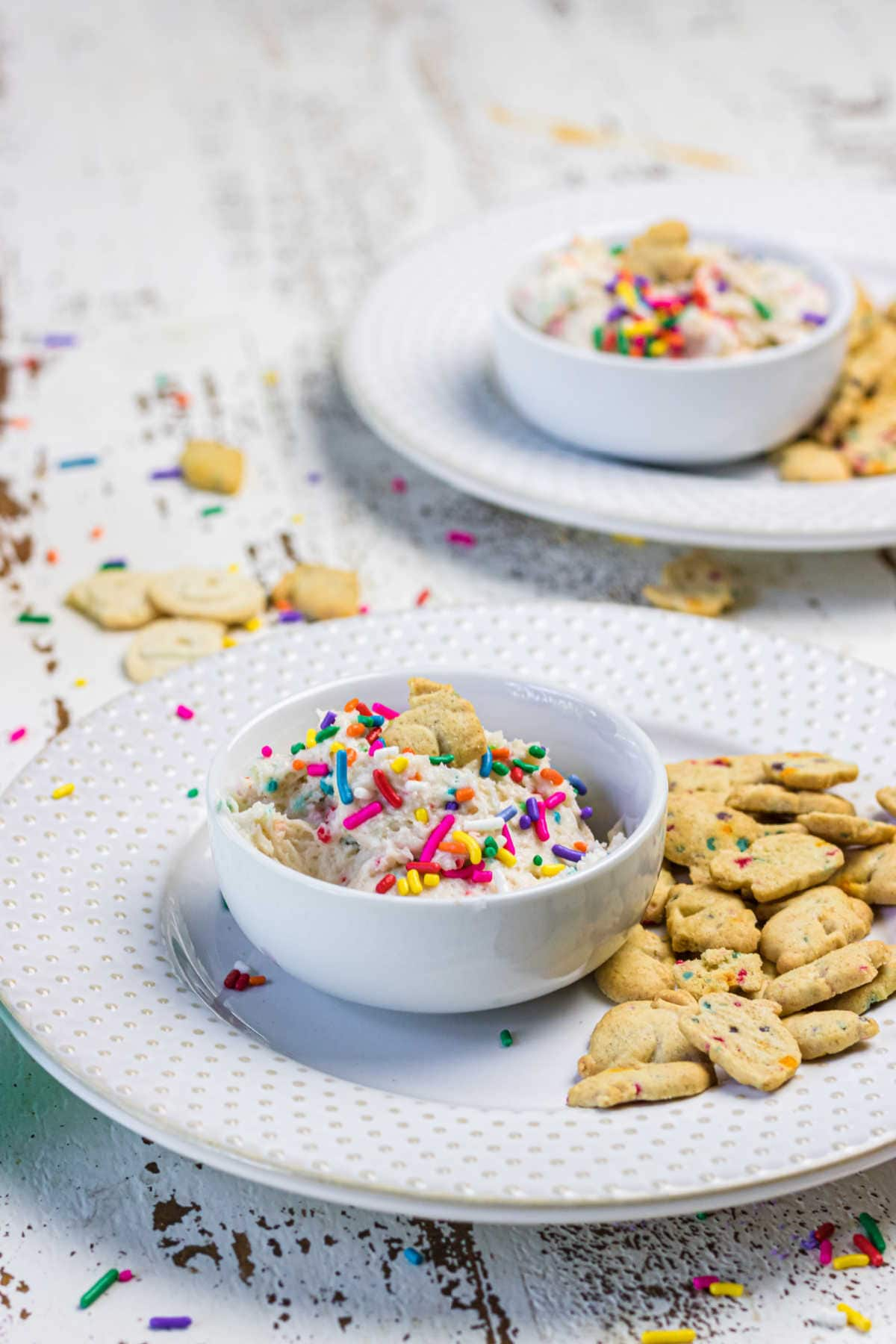 Decorative image - finished dip in small bowls with cookies nearby.